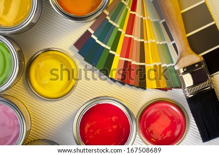 Selection of paint tester-pots with color charts and paintbrush - Interior Design - stock photo