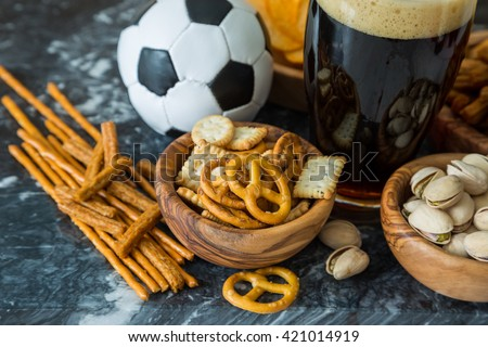 Selection of party food for watching football championship - stock photo