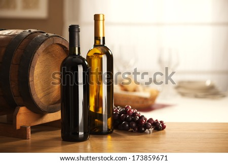 Selection of red and white wine with restaurant on background. - stock photo