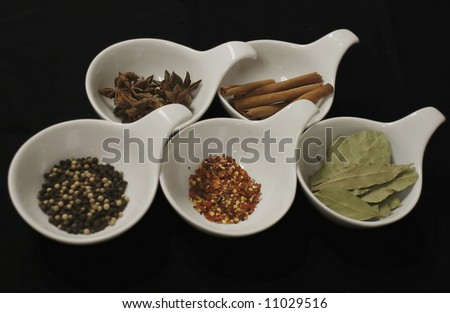 Selection of spices in decorative bowls