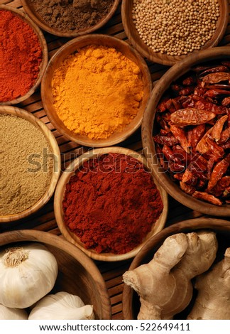 Selection of spices in wooden bowls