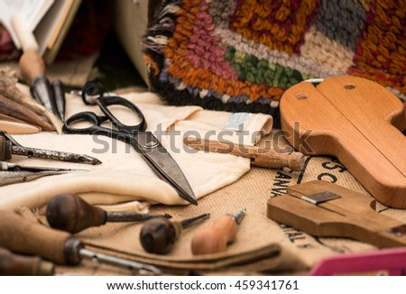 Selection of traditional tools used in the craft of carpet weaving by hand