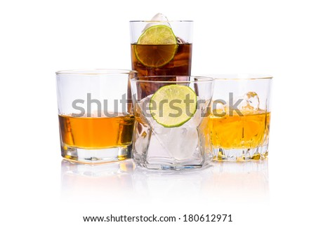 Selection of whiskey on ice over white background - stock photo