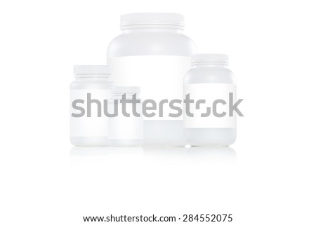 Selection of white plastic bottles with white label on white background - stock photo