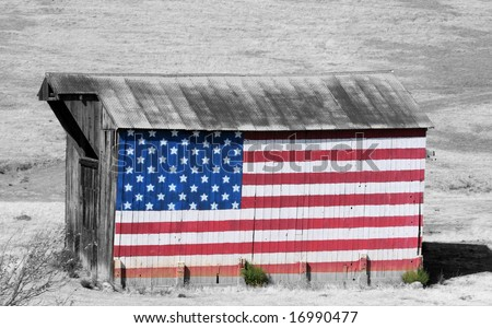 Selective color of a painted American Flag on a barn. - stock photo