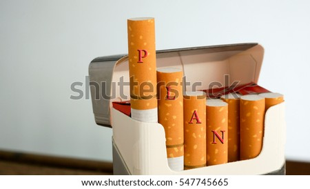 Selective focucing,shallow depth of field the written word PLAN on cigarettes.Quitting smoking and World No Tobacco Day Concept