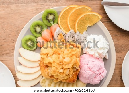 Selective focus and close up  dish of dessert prepare to serve : Fruity ice cream toast on the wooden. - stock photo