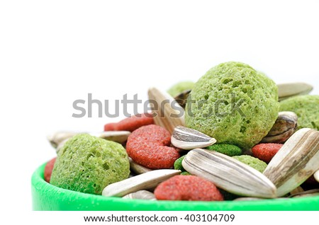 Selective focus and close up / Hamster food in green tray on white background (pets, food, hamster) - stock photo