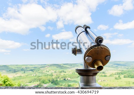Selective focus at telescope at the public tourist area and blue sky white cloud.