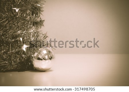 Selective focus ball Christmas decoration on wood and blur background by vintage tone and vignetting. - stock photo