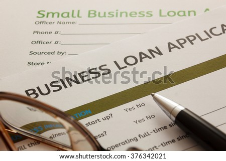 selective focus ,Business loan application form. Pen and glasses on  Business loan application form background. - stock photo