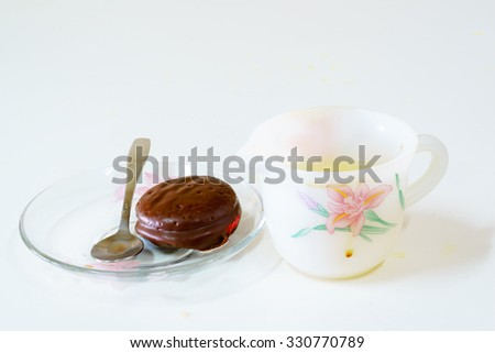 selective focus close up chocolate in white plate on white table with natural light in house in the morning. - stock photo