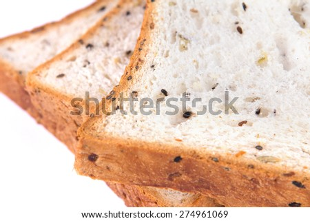 selective focus closeup the cereal and black sesame bread on white background - stock photo