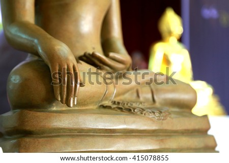 Selective Focus  Hands of  Buddha statue