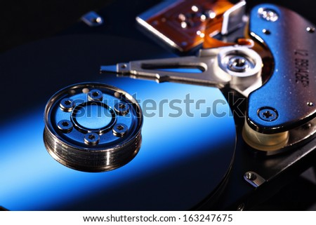 Selective focus hard disk close-up, blue - stock photo