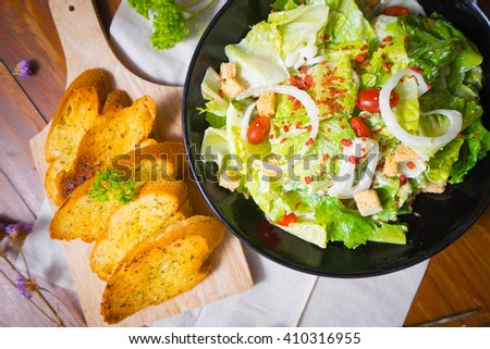 selective focus Healthy Grilled Chicken Caesar Salad with Cheese and Croutons - stock photo