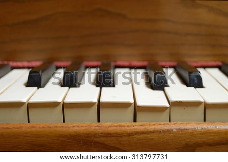 Selective focus image from the up front view of an old wooden piano. Blank copy space for editor's text - stock photo