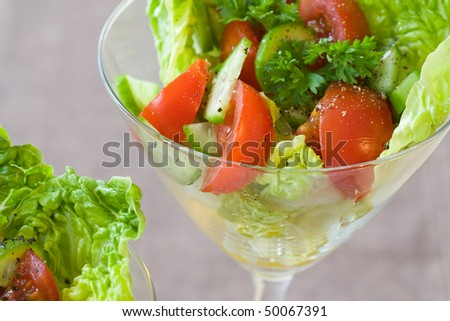 Selective focus image of a salad made from tomato, cucumber and parsley decorated in cocktail glasses