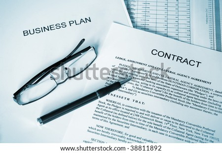 selective focus image of business plan, contract, ballpoint pen and glasses - stock photo