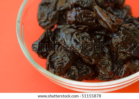Selective focus image of dried prunes which are often in cereal products like muesli.