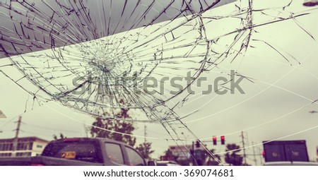 Selective focus image on Broken car windshield take photo from inside from accident of car.(vintage tone) - stock photo