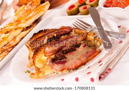 Selective focus in the middle of bacon and cheese on plate - stock photo