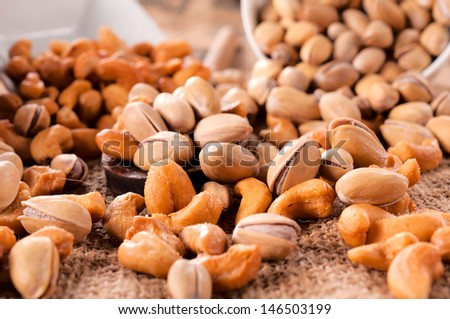Selective focus in the middle of pistachio and cashew nuts mix  - stock photo