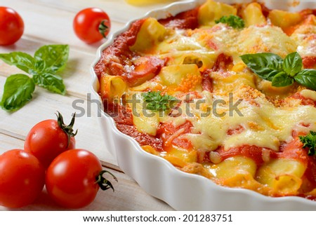 Selective focus in the middle of portion of canooli stuffed with cheese and meat  - stock photo