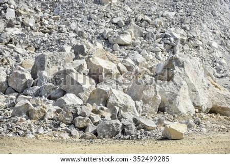 selective focus limestone pile on mining area - stock photo