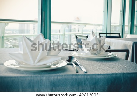 Selective focus luxury banquet table near window city view , Vintage filter - stock photo