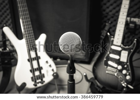 selective focus microphone and blur musical equipment electric guitar ,bass,loudspeaker background. - stock photo