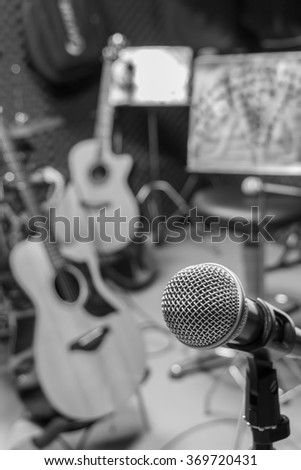 selective focus microphone and blur musical equipment guitar ,bass, drum  lyric stand, background. - stock photo