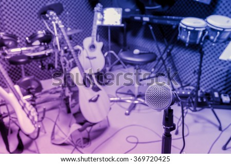 selective focus microphone and blur musical equipment guitar ,bass, drum piano, percussionist,lyric, background. - stock photo