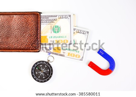 Selective Focus  : Money magnet concept with banknotes - stock photo