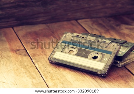 selective focus of Cassette tape over wooden table. image is instagram style filtered.  - stock photo