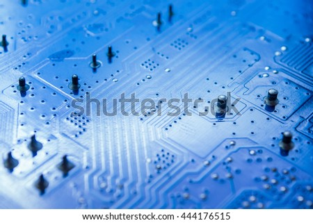 selective focus of close up the computer electronic circuit board , blue color tone - stock photo