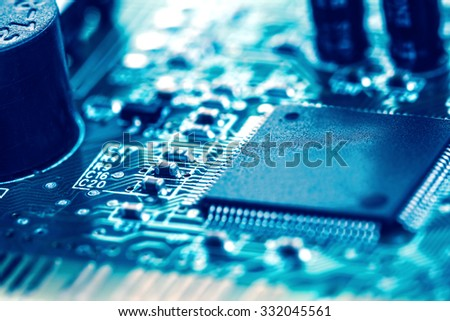 selective focus of close up the computer electronic circuit board , extremely shallow DOF - stock photo