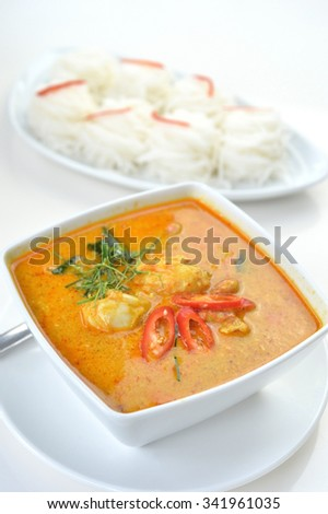 Selective focus of crab meat curry with fresh rice noodle, Thai cuisine - stock photo
