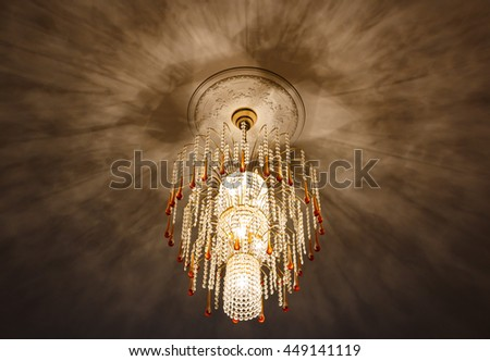 selective focus of Crystal Chandelier , ceiling lights, black shadows - stock photo