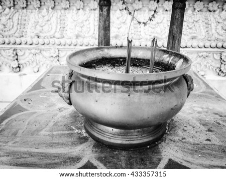 selective focus of  joss stick pot ; incense burner, vintage style effect and soft focus - stock photo
