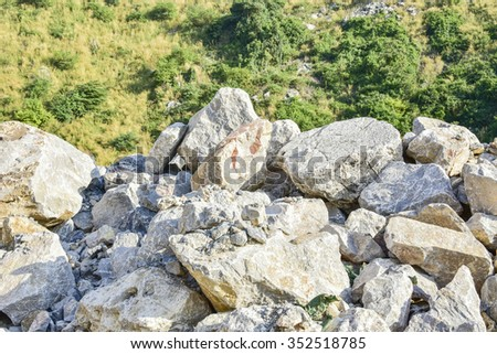 selective focus of limestone pile in mining area - stock photo