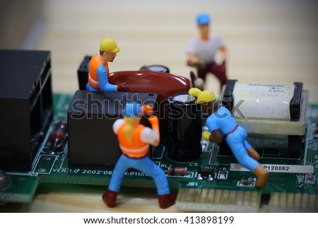 Selective focus of miniature engineer and worker fixed and maintenance mainboard computer. - stock photo