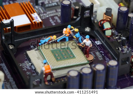 Selective focus of miniature engineer and worker fixed and repair CPU processor,  mainboard computer and for business. - stock photo