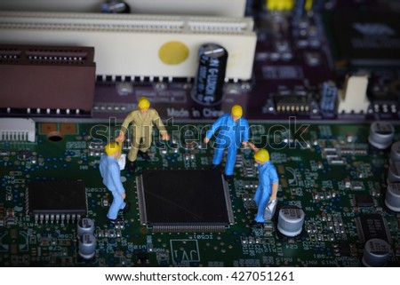 Selective focus of miniature engineer meeting, discuss and worker for design mainboard or fixed problem mainboard computer as technology and industrial concept. - stock photo