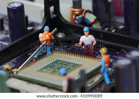 Selective focus of miniature engineer, worker break CPU fixed and repair CPU processor,  mainboard computer and use for business background. - stock photo
