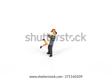 selective focus of miniature lover isolated on white background,abstract background to love valentine concept. - stock photo