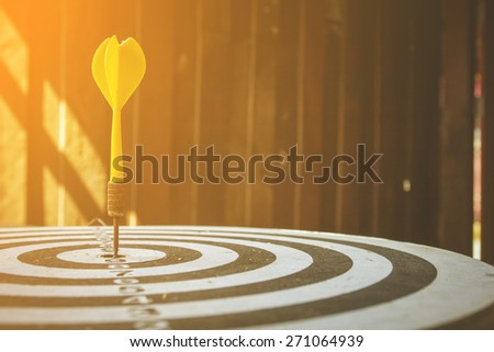 selective focus of old dart target with arrows vintage color tone ,abstract background to solution concept. - stock photo