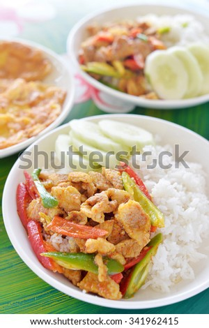 Selective focus of pork chili curry with jasmine rice and omelet - stock photo