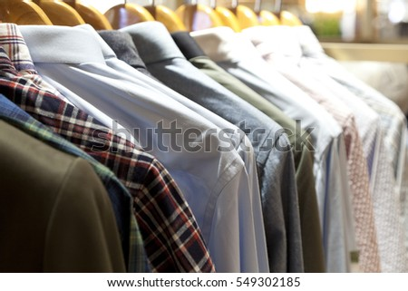 Selective focus of row of shirts hangers in a shop