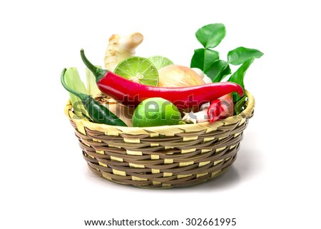 selective focus of the herb and spice ingredients in wooden basket on white background